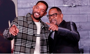 "FILE PHOTO: Cast members Will Smith (L) and Martin Lawrence pose at the premiere of ""Bad Boys for Life"" in Los Angeles, California, U.S., January 14, 2020. REUTERS/Mario Anzuoni/File Photo"