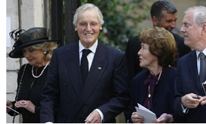 FILE PHOTO: British entertainers Nicholas Parsons (2nd L) and Gyles Brandreth (R) leave the funeral of Clement Freud at St Bride's church in London April 24, 2009. Freud was the grandson of Sigmund Freud, and his funeral took place on Friday, which would