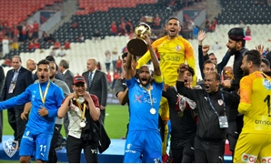 Zamalek captain Shikabala holds the Egyptian Super Cup award