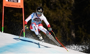 Gut-Behrami doubles up as Suter claims downhill globe