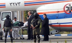 Former Egyptian president Hosni Mubarak is carried from an ambulance to a helicopter for his trial in Cairo, Egypt, Thursday, Jan. 5, 2012. AP Photo