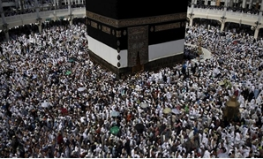 FILE - Muslim pilgrims pray around the holy Kaaba at the Grand Mosque, 2015 - Reuters