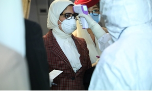 Minister of Health Hala Zayed and her accompanying delegation underwent examination and preventive measures immediately upon her arrival at Beijing airport Monday - Press photo