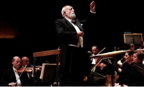 FILE PHOTO: Polish composer Krzysztof Penderecki conducts the Israel Philharmonic Orchestra during a performance of his Polish Requiem in Tel Aviv February 12, 2014. REUTERS/Finbarr O'Reilly/File Photo