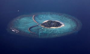 FILE PHOTO: An areal view shows a resort island in the Maldives December 14, 2009. REUTERS/Reinhard Krause/File Photo