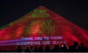 File-Great Pyramid of Giza lit up with coronavirus messages .