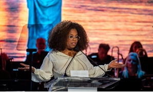 FILE PHOTO: Oprah Winfrey speaks at the opening celebration of the Statue of Liberty Museum on Liberty Island in New York, U.S., May 15, 2019. REUTERS/Demetrius Freeman/File Photo.