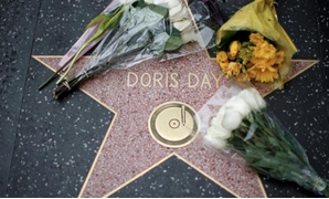 FILE PHOTO: Flowers are pictured by the star of late actor Doris Day on the Hollywood Walk of Fame in Los Angeles, California, U.S., May 13, 2019. REUTERS/Mario Anzuoni/File Photo