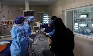 Nurses wearing protective suits, prepare a patient with coronavirus to be transferred to Masih Daneshvari Hospital in Tehran. Iran's 2,987 new coronavirus cases brought the total to 47,593. (West Asia News Agency/Reuters)