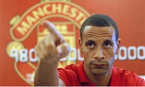 Manchester United defender Rio Ferdinand talks to reporters during a meeting with fans at the English Premier League Asia trophy tour in Jakarta June 30, 2011. REUTERS/Beawiharta
