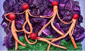 "A view shows a replica of ""The Dance"" painting by French artist Henri Matisse made of sausages, red cabbage, spinach and other food items in Kiev, Ukraine in this undated handout image. Olesia Marchenko/Handout via REUTERS"