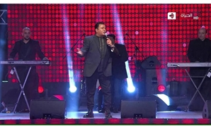 Fouad in the concert's promo on Al-Hayah TV - Captured photo from official promo