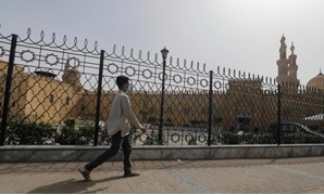 FILE - A man walks past the closed al-Azhar Mosque in Cairo which has been closed along with other places of worship to stop the spread of coronavirus in Egypt – Reuters