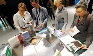 FILE PHOTO: Visitors examine books at Frankfurt book fair in Frankfurt, Germany, October 17, 2019. REUTERS/Ralph Orlowski