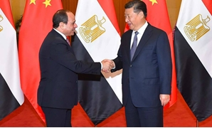 A handout picture released by the Egyptian Presidency on Saturday shows Egyptian President Abdel Fattah El-Sisi (L) shaking hands with China's President Xi Jinping upon the former's arrival in the Chinese capital Beijing. — AFP