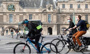 FILE PHOTO: Bikers ride past the Louvre museum after France began a gradual end to a nationwide lockdown due to the coronavirus disease (COVID-19), in Paris, France, May 13, 2020. REUTERS/Charles Platiau