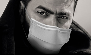 Tamer Hosni wearing a face-mask - ET