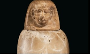 One of the ancient Egyptian Canopic containers set for sale in Christie's Auction House - ET