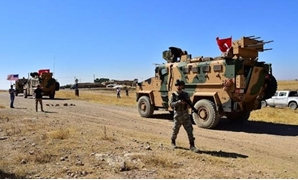 FILE PHOTO - Turkish and U.S. military vehicles are seen during a joint U.S.-Turkey patrol in a Syrian border village near Tel Abyad, Syria, September 8, 2019.Turkish Defence Ministry/Handout via REUTERS
