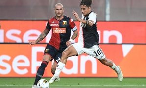 Soccer Football - Serie A - Genoa v Juventus - Stadio Comunale Luigi Ferraris, Genoa, Italy - June 30, 2020 Juventus' Paulo Dybala in action with Genoa's Stefano Sturaro, as play resumes behind closed doors following the outbreak of the coronavirus diseas