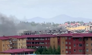 Smoke rises over Addis Ababa skyline during protests following the fatal shooting of the Ethiopian musician Haacaaluu Hundeessaa, in Addis Ababa, Ethiopia June 30, 2020, in this screengrab taken from a video. Picture taken June 30, 2020. REUTERS/Stringer
