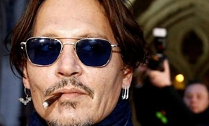 FILE PHOTO: Actor Johnny Depp leaves the High Court in London, Britain, February 26, 2020. REUTERS/Henry Nicholls TPX IMAGES OF THE DAY/File Photo.