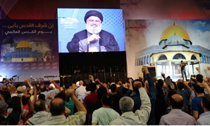 Lebanon's Hezbollah leader Sayyed Hassan Nasrallah addresses his supporters via a screen during a rally marking Al-Quds day in Beirut's southern suburbs, Lebanon June 23, 2017. REUTERS