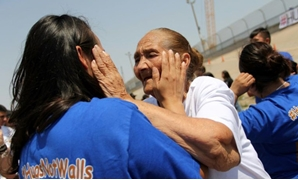 "Families separated by the US-Mexico border are reunited for a few minutes in a ""Hugs Not Walls"" event in Ciudad Juarez, Mexico on June 24, 2017- AFP"