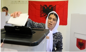 A woman casts her vote during the parliamentary election in Surel near Tirana, Albania June 25, 2017. REUTERS/Florion Goga